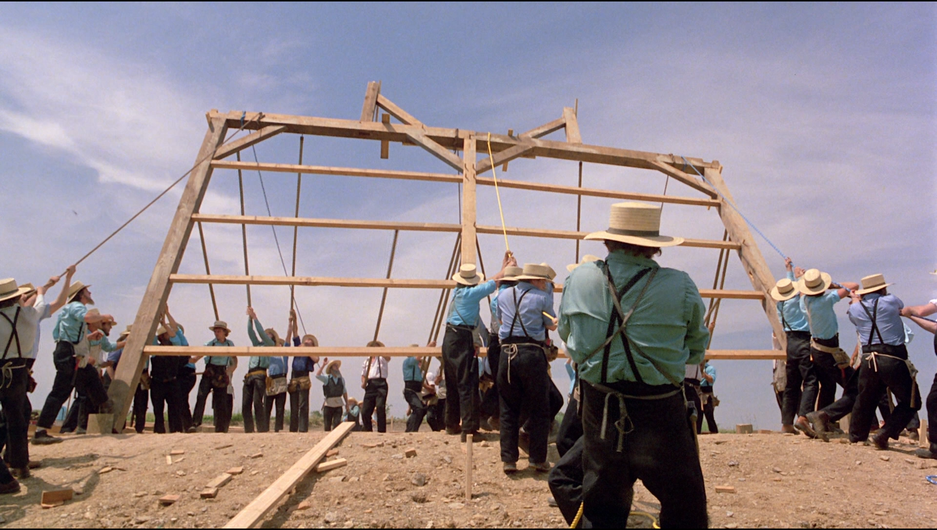 witness barn raising The film witness directed by peter weir raises questions about the  the barn  raising scene captures this idea effectively as it portrays the.