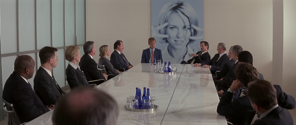 Brand Stand (Jude Law) in a meeting in I Heart Huckabees
