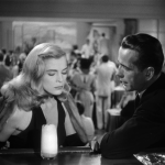 Bogart interrogates Lizabeth Scott at the bar in Dead Reckoning