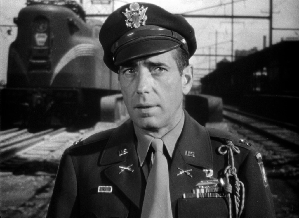 Bogart hits the tracks. One of many in studio 'process' shots that in the 1950s would have certainly been shot on location.