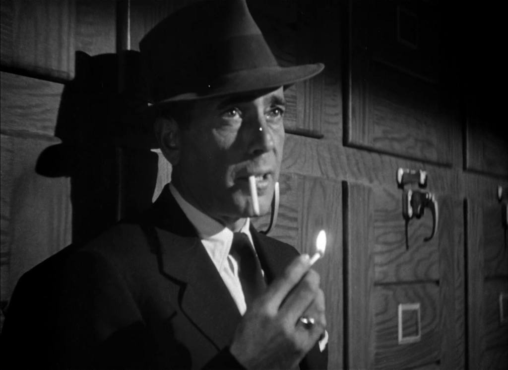Everyone smokes. All. The. Time. Bogart lights up in the morgue.